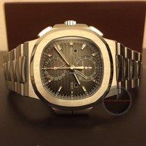 Patek Philippe Nautilus 5990/1A Travel Time Chronograph...