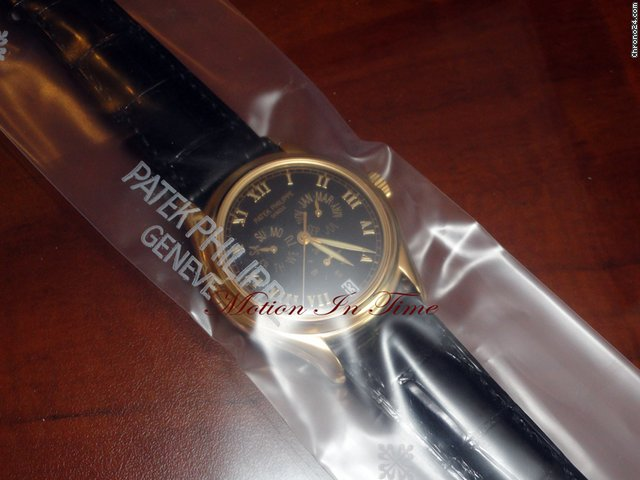 Patek Philippe 5035j ANNUAL CALENDAR YELLOW GOLD RARE BLACK DIAL - SEALED