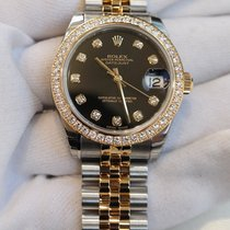 Rolex Datejust 31 black dial in stainless steel and yellow...