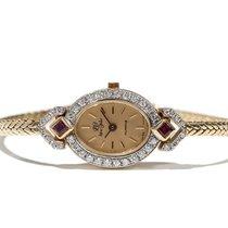 14 carat gold women's wristwatch with diamonds & rubies