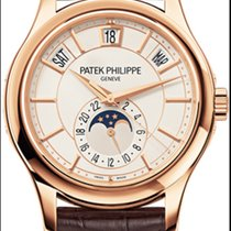 Patek Philippe Annual Calendar 5205R Rose Gold Cream Dial...
