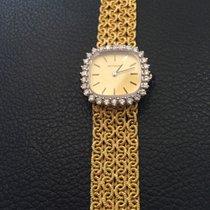 Movado 18k gold w diamond bezel