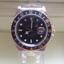Rolex GMT 16713 STEEL AND GOLD  DIAL BLACK