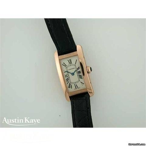 Cartier Tank Americaine 18ct gold quartz on strap.