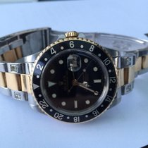 Rolex GMT Steel Gold Black Dial Saphire glass