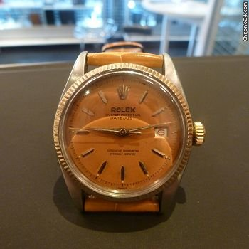 Rolex vintage big bubble back 6605 with incredible caramel patina-pink gold and steel mvt 1065