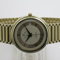 "Milus ""Classic Automatic"" 14K gold case and bracelet"