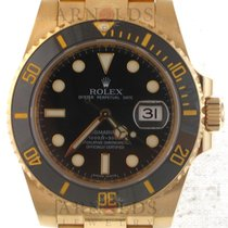 Rolex 18kt Yellow Gold Submariner Black Dial And Black Bezel
