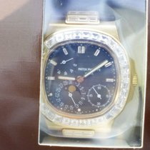 Patek Philippe Nautilus Rose Gold & Baguette Diamond -...