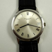 Patek Philippe 18K automatic date with extract