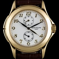 Patek Philippe 18k Yellow Gold White Dial Travel Time Gents...