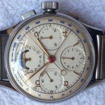 Tourneau chrono rattrappante con data e fasi luna