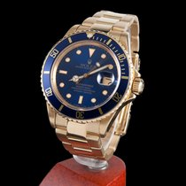 Rolex submariner 300m date yellow gold blue dial