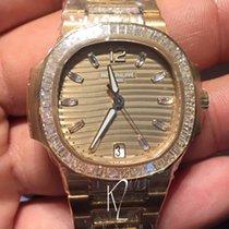 Patek Philippe 7014/1R Nautilus lady rose gold baguette diamonds