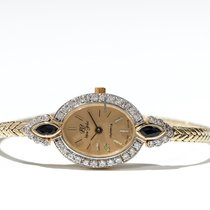 14 carat gold women's wristwatch with diamonds & sapphires